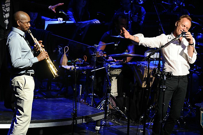 "NEW YORK - JULY 13: Branford Marsalis (L) and Sting perform during his ""Symphonicity"" Tour, featuring the Royal Philharmonic Concert Orchestra at The Metropolitan Opera House on July 13, 2010 in New York City. (Photo by Theo Wargo/WireImage)"